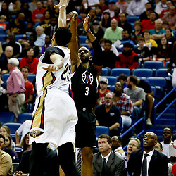Dec 28, 2016; New Orleans, LA, USA;  Los Angeles Clippers guard Chris Paul (3) shoots over New Orleans Pelicans forward Anthony Davis (23) during the first quarter of a game at the Smoothie King Center. Mandatory Credit: Derick E. Hingle-USA TODAY Sports