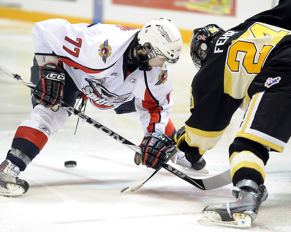 Scott Timmins of the Windsor Spitfires and Jay Fehr of the Brandon Wheat Kings faceoff in the opening game of the 2010 MasterCard Memorial Cup in Brandon, MB. Photo by Aaron Bell/CHL Images