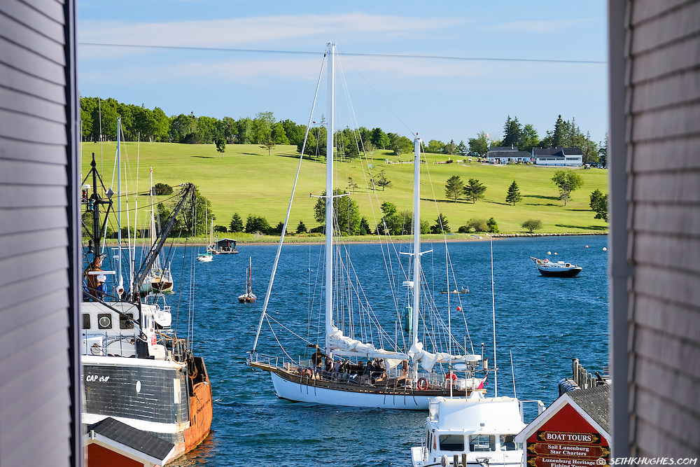 A boat load of sailing tourists in Lunenburg, Nova Scotia, Canada.