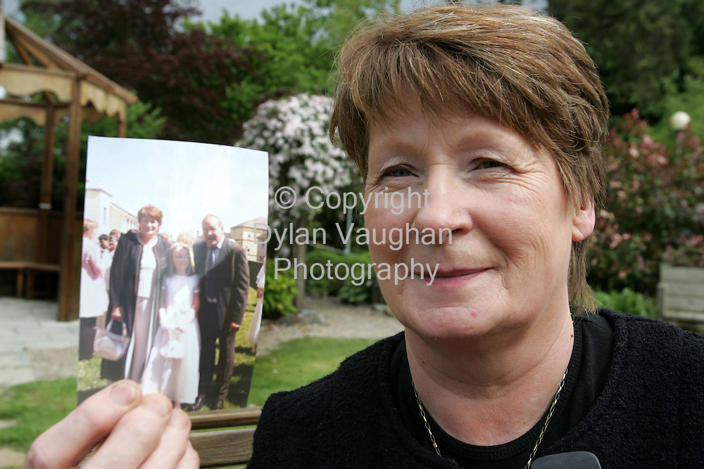 20/5/2005.Margaret Dawson founder of the MRSA Group pictured in Kilkenny yesterday with a picture of her husband (far left of group) at a family get together..Picture Dylan Vaughan