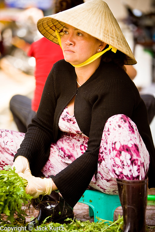 09 MARCH 2006 - HO CHI MINH CITY, VIETNAM: A market vendors cleans vegetables in Ben Thanh Market in Ho Chi Minh City (formerly Saigon) Vietnam. Many Vietnamese do not have refrigerators in their homes, so they shop in the markets almost every day. Photo by Jack Kurtz