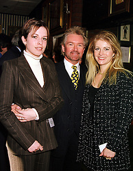 Left to right, MISS CHARLOTTE EDMONDS and her parents MR & MRS NOEL EDMONDS he is the TV presenter, at a reception in London on 9th March 1999.MPE 21