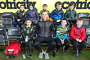 Forest Green Rovers Joseph Mills(23) with school group during the EFL Sky Bet League 2 match between Forest Green Rovers and Walsall at the New Lawn, Forest Green, United Kingdom on 8 February 2020.