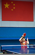 A boy returns a table tennis ball as he trains in the Shichahai Sports School in Beijing. Shichahai is one of China's top sports schools, whose goal is to create Olympic champions. Four to five hours a day the 600 resident students train in the school's gymnasiums for table tennis, wushu, gymnastics, volleyball, boxing or taekwondo.