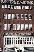 Amsterdam, Holland.  Facade of the Gunters & Meuser Handel  in Ijzerwarden  building.