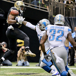 Dec 21, 2015; New Orleans, LA, USA; New Orleans Saints tight end Benjamin Watson (82) has a pass broken up by Detroit Lions middle linebacker Tahir Whitehead (59) during the second half of a game at the Mercedes-Benz Superdome. The Lions defeated the Saints 35-27. Mandatory Credit: Derick E. Hingle-USA TODAY Sports