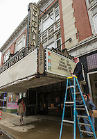 John Moriaty puts the announcement on the marque of the Colonial Theater after Monday mornings press conference held at the Wayfarer Coffee Shop on Main Street.  (Karen Bobotas/for the Laconia Daily Sun)
