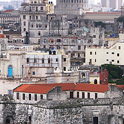 A Unesco World Heritage site, the Castillo de la Real Fuerza bordering the Plaza de Armas in La Habana Vieja.The construction of the castle was finished in 1577. Towering over some of old buildings is the Capitol. Photography by Jose More