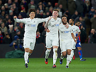 Alfie Mawson of Swansea City celebrates after scoring the opening goal with Neil Taylor (right) and Ki Sung-Yueng (left) during the Premier League match at Selhurst Park, London<br /> Picture by Alan Stanford/Focus Images Ltd +44 7915 056117<br /> 03/01/2017