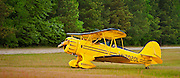 A classic WACO biplane in the grass at Briscoe Field in Lawrenceville, Georgia.  1999 WACO Classic Aircraft Corporation, model YMF-5C, with a 275 horsepower Jacobs radial engine.