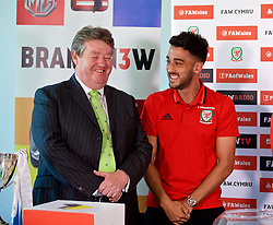 CARDIFF, WALES - Thursday, August 31, 2017: Nathaniel Cars' Wayne Griffiths with Wales' Neil Taylor during the 2nd round draw for the FAW Welsh Premier League Cup at the Vale Resort. (Pic by David Rawcliffe/Propaganda)