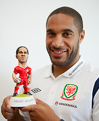CARDIFF, WALES - Friday, September 7, 2012: Wales' Ashley Williams with his Grogg caricature at the St. David's Hotel ahead of the Brazil 2014 FIFA World Cup Qualifying Group A match against Belgium. (Pic by David Rawcliffe/Propaganda)