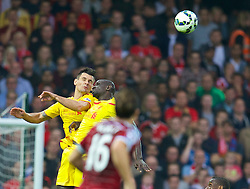 LONDON, ENGLAND - Saturday, September 20, 2014: Liverpool's Dejan Lovren clashes with Mamadou Sakho against West Ham United during the Premier League match at Upton Park. (Pic by David Rawcliffe/Propaganda)