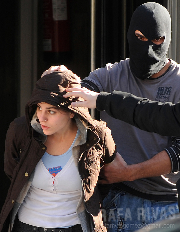 An unidentified suspect of being a member of pro-independence young Basque association SEGI arrives at the National Police headqurters after her arrest, on November 24, 2009, in the northern Spanish Basque city of San Sebastian. 36 people were arrested by Spanish National Police during an anti-terrorist operation, in the Basque Country and Navarra, ordered by Spanish judge Grande Marlaska.  PHOTO/Rafa Rivas
