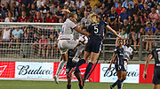 North Carolina Courage midfielder Samantha Mewis (5) and Olympique Lyonnais forward Ada Hegerberg (14) go up for a header during an International Champions Cup women's soccer game, Sunday, Aug. 18, 2019, in Cary, Olympique Lyonnais bested the North Carolina Courage 1-0 in the finals.  (Brian Villanueva/Image of Sport)