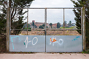 """1-O"" graffiti- referring to the October 1st 2017 Catalan independence referendum, which went ahead, despite violent crackdowns by Spanish police against voters. Photographed Sant Cugat del Valles, Barcelona, Catalonia. Spanish flag sticker has been partly scraped off the gate."