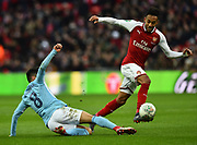 Pierre-Emerick Aubameyang (14) of Arsenal rides the challenge by Ilkay Gundogan (8) of Manchester City during the EFL Cup Final match between Arsenal and Manchester City at Wembley Stadium, London, England on 25 February 2018. Picture by Graham Hunt.