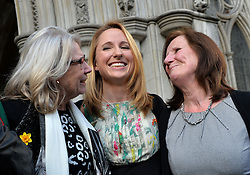 (l-r) Helen Brewer (Beth's mother-in-law), Beth Warren, and Georgina Hyde (Beth's mother). Widow Beth Warren leaves The High Court, London, UK, after winning her fight with the High Court to preserve her late husband's sperm.<br /> Thursday, 6th March 2014. Picture by Ben Stevens / i-Images