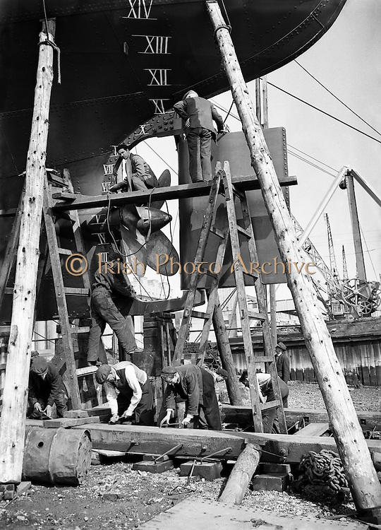 Shipping - Launching of Irish Ferries - Workmen put Finishing Touches to the Irish Fern.26/08/1954..Several vessels of different types were delivered in the early 1950s, Irish Oak, a near sister to the 1948 Irish Pine. Both of these vessels were steamships, with triple expansion reciprocating engines, converted to motor vessels in the mid fifties and powered by Doxford diesel engines. Two sisterships were delivered in 1952 and 1954:.Irish Heather 1952 to 1964.Irish Fern 1954 to 1964