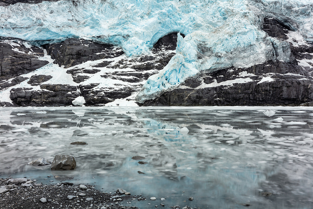 Long exposure of rising tide at base of Cascade Glacier in Harriman Fjord in  Southcentral Alaska. Summer. Morning.
