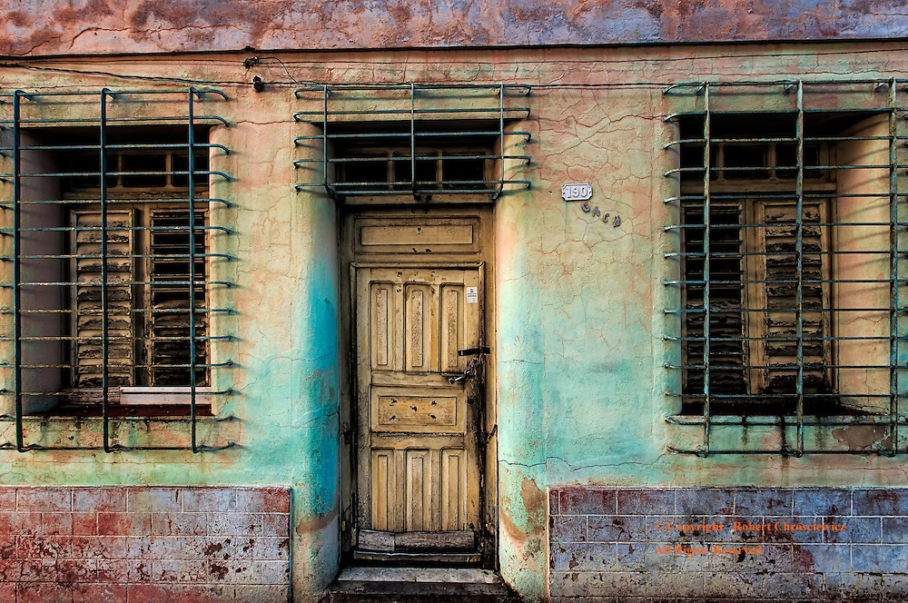 Beautifully Secure:  A rather dilapidated and locked down home is revealed to have an inherent beauty when caught in an early morning light, Bayamo Cuba.
