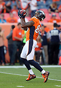 An official steadies Denver Broncos wide receiver Demaryius Thomas (88) catches an over the shoulder pass while warming up before the 2016 NFL week 1 regular season football game against the Carolina Panthers on Thursday, Sept. 8, 2016 in Denver. The Broncos won the game 21-20. (©Paul Anthony Spinelli)