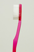 profile of a new red toothbrush