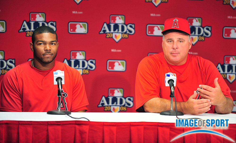 Oct 2 2008; Anaheim, CA, USA; Los Angeles Angels second baseman Howie  Kendrick (47), left, and manager Mike Scioscia (14) at ALDS press conference at Angel Stadium.