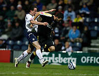 Photo: Paul Greenwood/Sportsbeat Images.<br />Preston North End v Cardiff City. Coca Cola Championship. 29/12/2007.<br />Preston's Sean St Ledger, (L) tussles for the ball with Joe Ledley