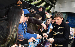 Eddie Redmayne signs autographs for fans during the Early Man World Premiere held at the BFI Imax, London.