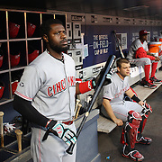 NEW YORK, NEW YORK - APRIL 25: Brandon Phillips #4 of the Cincinnati Reds preparing to bat in the dugout during the New York Mets Vs Cincinnati Reds MLB regular season game at Citi Field on April 25, 2016 in New York City. (Photo by Tim Clayton/Corbis via Getty Images)