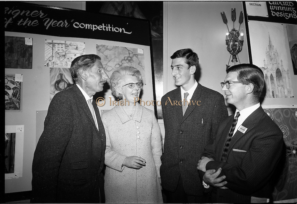 """28/06/1967<br /> 06/28/1967<br /> 28 June 1967<br /> Presentation of prizes at Navan Carpets """"Young Designer of the Year"""" reception in the Royal Hibernian Hotel, Dublin. Image shows (l-r):Mr. Michael Bourke, Principal of the National College of Art; Mrs C. Duane; Joseph Duane (prizewinner), Co. Galway and Mr. Wilson, Navan Carpets Ltd at the reception."""