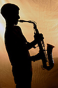 Silhouette of a Saxophone player - close up