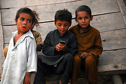 59577854  .Afghan refugee children rest at a slum on the outskirts of Islamabad, capital of Pakistan on April 27, 2013.  The UN refugee agency (UNHCR) said on Wednesday that over 83,000 Afghan refugees were repatriated from Pakistan in 2012, on April 27, 2013, 29, April. Photo by: i-Images.UK ONLY