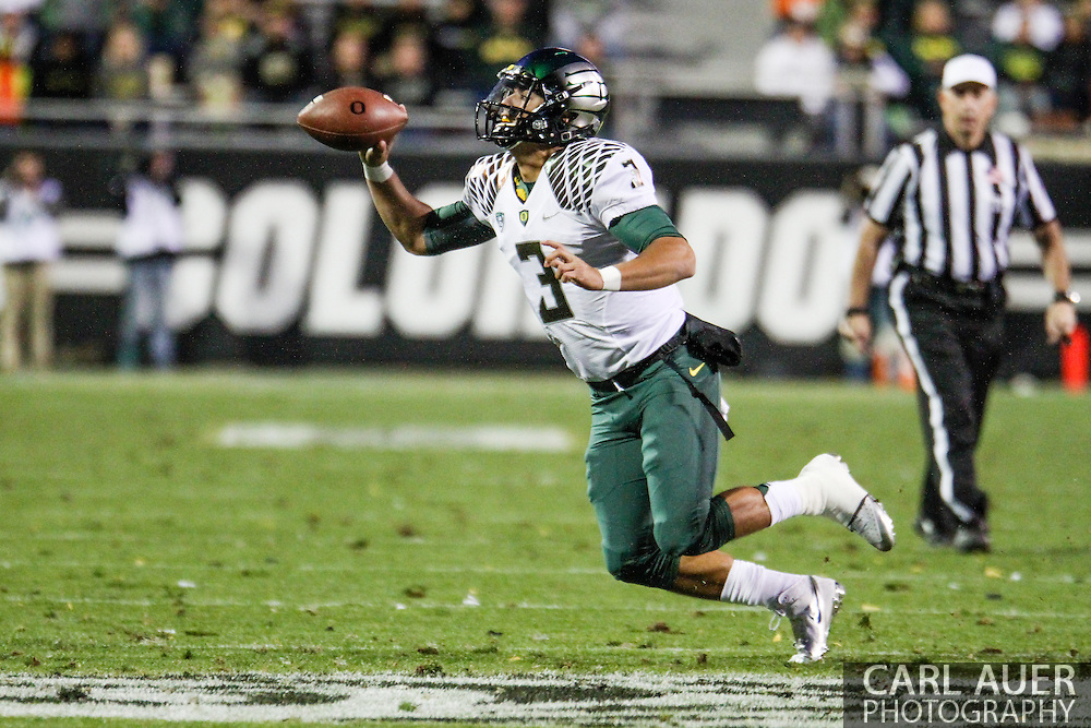 October 5th, 2013:  University of Oregon Ducks freshman quarterback Jake Rodrigues (3) makes a short pass in the fourth quarter of the NCAA football game between the University of Oregon Ducks and the Colorado Buffaloes at Folsom Field in Boulder, Colorado