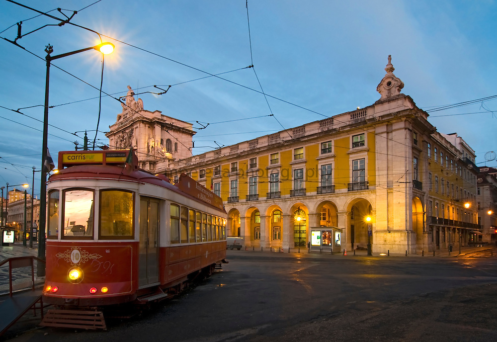 Tram at the Comercio scuare in Lisbon at dawn