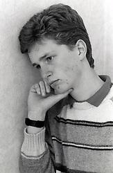 Teenage boy looking pensive, Nottingham, UK 1990