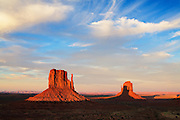 The West Mitten's shadow is cast on the East Mitten at sunset. Monument Valley, Arizona.