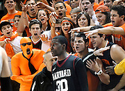 Princeton fans yell toward the direction of Harvard's Kyle Casey (30) as he waits to inbound a pass during first half of an NCAA college basketball game in a playoff for the Ivy League championship at Yale University in New Haven, Conn., Saturday, March 12, 2011.(AP Photo/Jessica Hill)