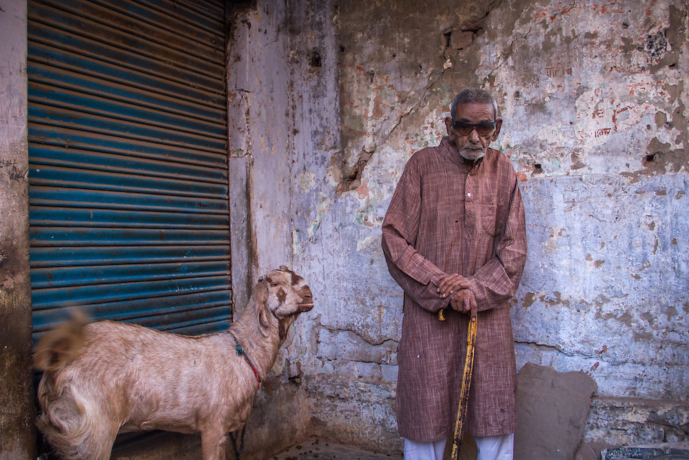 An old man in front of his house in a back alley of the old city of Agra, a short walk from the Taj Mahal.