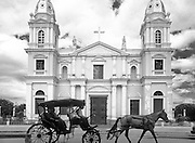 Front view of cathedral with horse carriage in the foreground