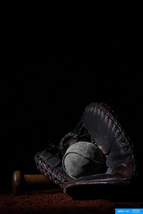 A vintage antique baseball glove, used baseball and baseball bat. 7th June 2012. Photo Tim Clayton