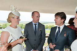 Left to right, ZARA TINDALL, WADE EASTWOOD and TOM CRUISE at the 2014 Glorious Goodwood Racing Festival at Goodwood racecourse, West Sussex on 31st July 2014.