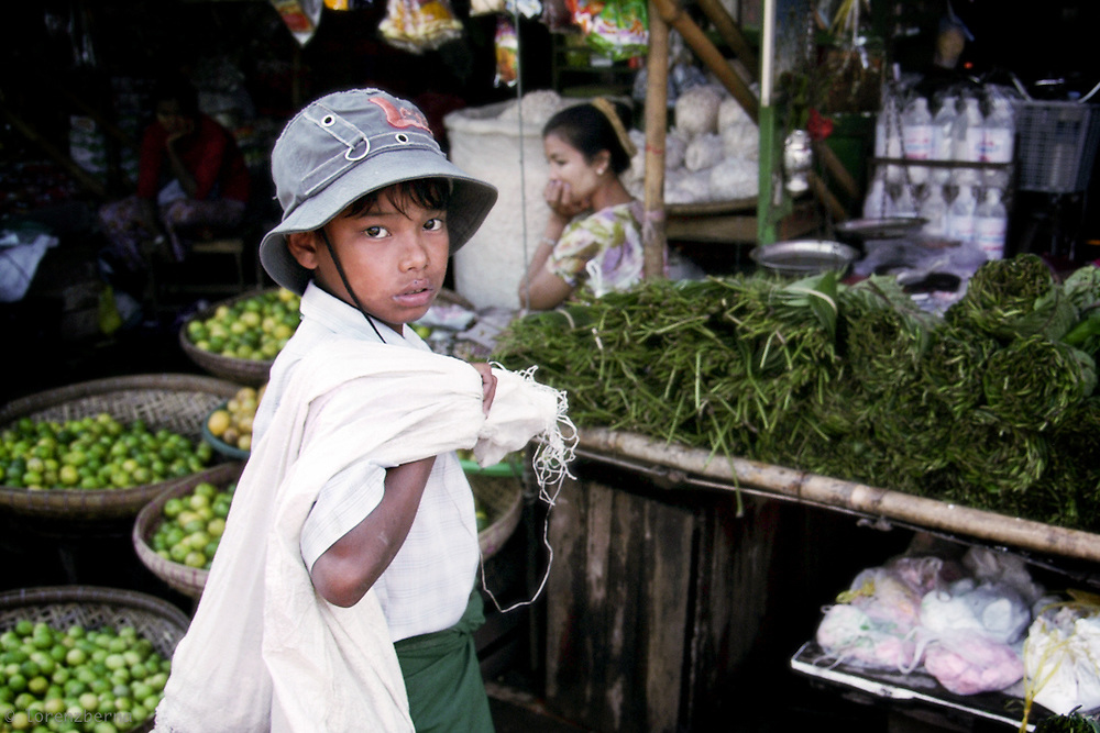 A young Burmese worker in the Market of Bago, Myanmar. More than 1.5 million children between 10 and 17 years of age are working in the country.