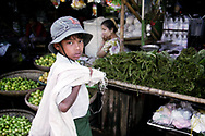 A young Burmese worker in the Market of Bago, Myanmar. More than 1.5 million children between 10 and 17 years of age are working in the country. Photo by Lorenz Berna