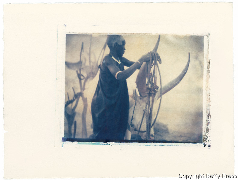 Dinka Woman tending cattle, South Sudan<br />