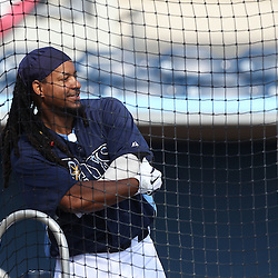 March 15, 2011; Port Charlotte, FL, USA; Tampa Bay Rays left fielder Manny Ramirez (24) watches batting practice before a spring training exhibition game against the Florida Marlins at Charlotte Sports Park.   Mandatory Credit: Derick E. Hingle