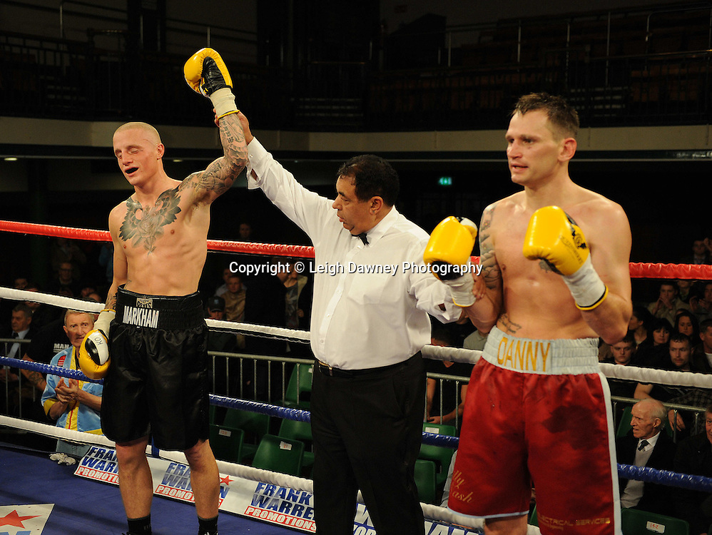Lee Markham (black shorts) defeats Danny Brown in a 4x3 min rounds Middleweight contest at York Hall, Bethnal Green, London on 14th December 2011. Frank Warren Promotions. Photo credit: © Leigh Dawney 2011.