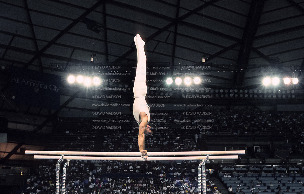 SEATTLE - JULY 1990:  Toth Balazs of Hungary performs on the parallel bars during the gymnastics competition of the 1990 Goodwill Games held from July 20 - August 5, 1990.  The gymnastics venue was the Tacoma Dome in Tacoma, Washington.  (Photo by David Madison/Getty Images)
