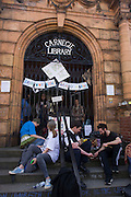 London, UK 2nd April: A campaigner and policeman play backgammon on the steps of the closed Carnegie Library, in Herne Hill, south London on 2nd April 2016. The angry local community in the south London borough have occupied their important resource for learning and social hub for the weekend. After a long campaign by locals, Lambeth have gone ahead and closed the library's doors for the last time because they say, cuts to their budget mean millions must be saved. A gym will replace the working library and while some of the 20,000 books on shelves will remain, no librarians will be present to administer it. London borough's budget cuts mean four of its 10 libraries will either close, move or be run by volunteers. ©Richard Baker / Alamy Live News.